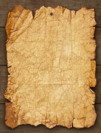 Versleten en gescheurd papier geplakt op hout achtergrond met kopie ruimte. Stockfoto - 38249478