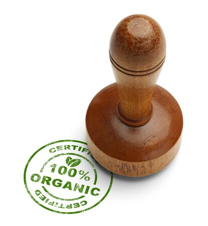 Green 100% Certified Organic Stamp with Wooden Stamper Isolated on White Background. photo