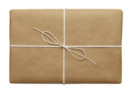 brown: Brown Parcel With Thin Tied Rope Isolated On White Background. Stock Photo