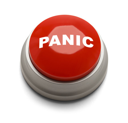 panic button: Red button with panic printed on it isolated on a white background. Stock Photo