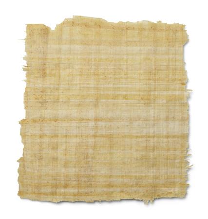 白い背景に分離された黄色茶色パピルス紙を引き裂かれました。 写真素材