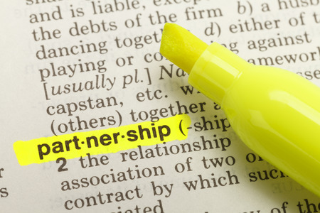 The Word Partnership Highlighted in Dictionary with Yellow Marker Highlighter Pen. Stok Fotoğraf
