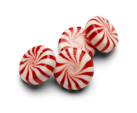 Four Pieces of Peppermint Candy With Swirls Isolated on White Background. Stock Photo