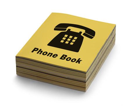 Geel Telefoonboek met zwarte telefoon op dekking die op een witte achtergrond.