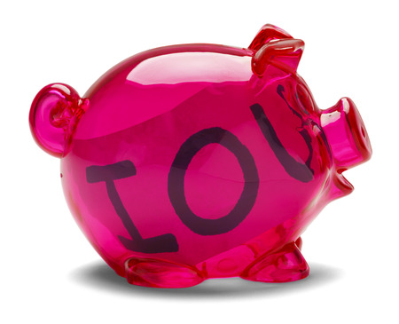Pink piggy bank with Iou note inside isolated on white background.