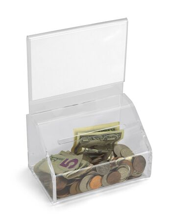 depositing: Clear Plastic Donation Box With Money and Copy Space Isolated on White Background. Stock Photo