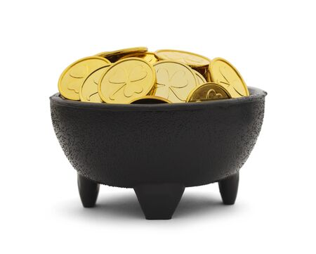 saint pattys: Black Pot with Clover Gold Coins Isolated on White Background.