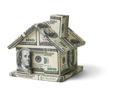 loans: House Made of Cash Money Isolated on White Background. Stock Photo