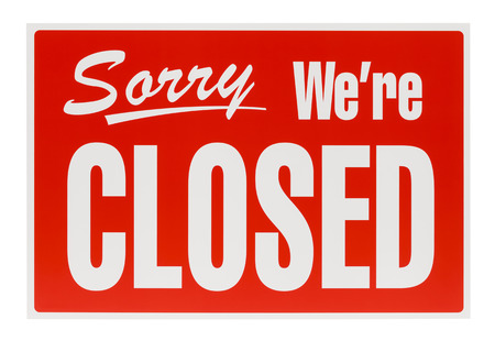 Plastic Sorry Were Closed Sign Isolated on White Background. photo