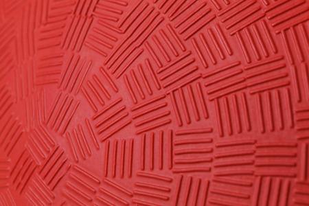 赤いゴムボールの模様。