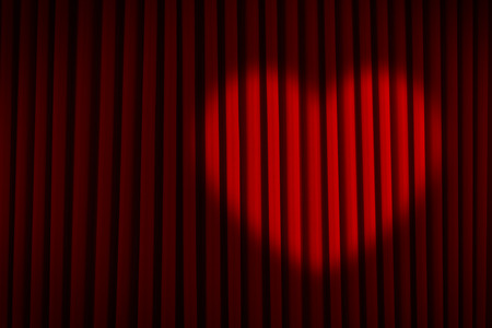 arts culture and entertainment: Red Velvet Stage Curtain with Heart Spotlight. Stock Photo