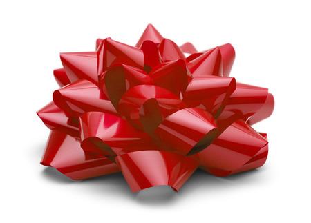 moños navideños: Satén Rojo arco lado ver aislado en el fondo blanco. Foto de archivo