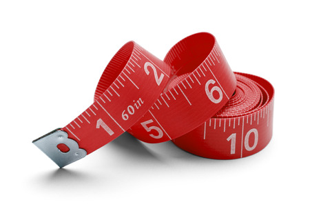 Rolled up and twisted sewing tape measure Isolated on white background. photo