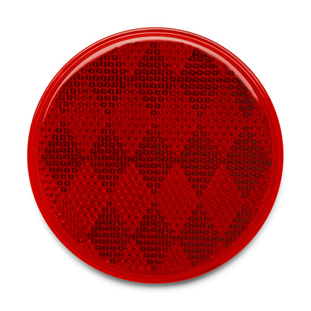 Red Round Plastic Reflector Isolated on White Background.