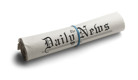 Rolled Up Newspaper with Rubber Band of the Daily News. Isolated on a White Background.