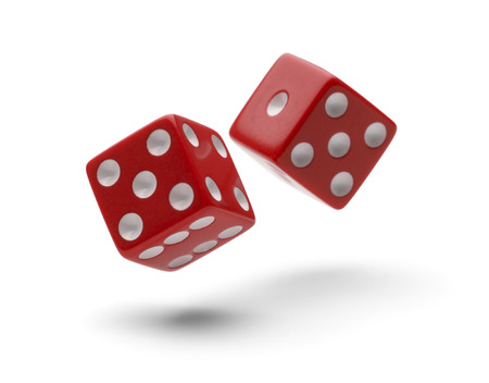 Red Dice in Air Rolling with Shawdows Isolated on White Background.