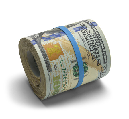 Hundred dollar bills rolled up with rubberband. photo