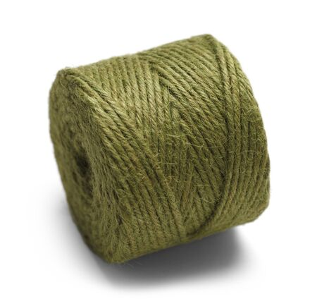 needlecraft product: Green Rope Wound in a Spool Isolated on White Background.