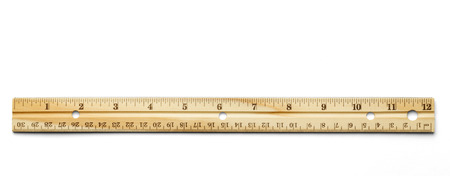 Classic wood ruler isolated on a white background. Foto de archivo