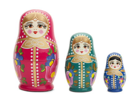 Three Traditional Russian Wood Dolls Isolated on White Background. Stock Photo