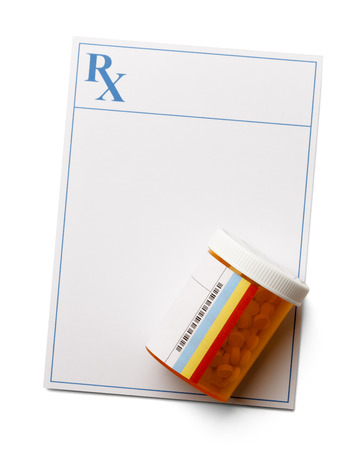 pill bottle prescription bottle: Prescription with pill bottle filled with medicine. Copy space and isolated on a white background.
