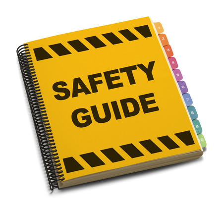 safety: Yellow Spiral Safety Guide Book Isolated on White Background.