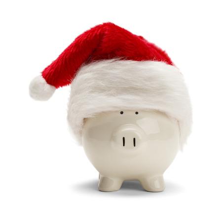 cuenta bancaria: Hucha con sombrero de Santa aisladas sobre fondo blanco. Foto de archivo