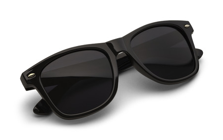 black and white photography: Folded Black Sunglasses Isolated on White Background with Clipping Path.