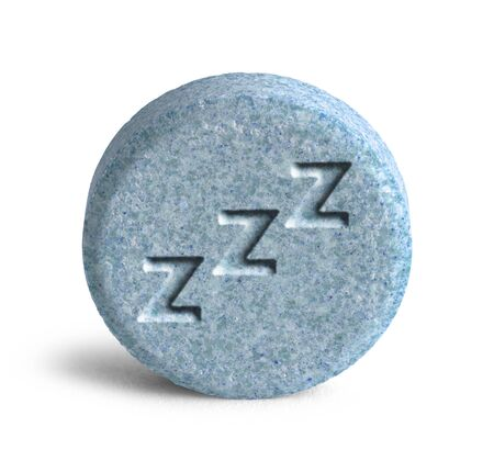 Blue Sleeping Pill with Three Z Isolated on White Background. photo