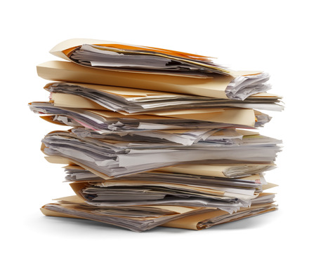 office documents: Files stacking up in a messy order isolated on white background. Stock Photo