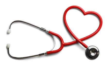 白い背景で隔離の心の形に赤い聴診器。 写真素材