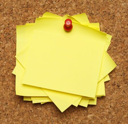 paper pin: Bunch of sticky notes tacked to cork board. Stock Photo