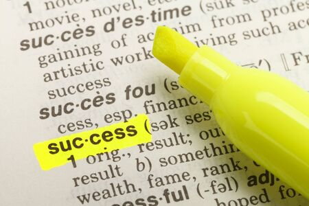 single word: The Word Success Highlighted in Dictionary with Yellow Marker Highlighter Pen. Stock Photo