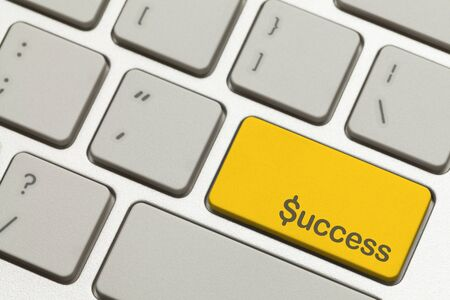 Close Up of Gold Success Key Button on a Keyboard. photo