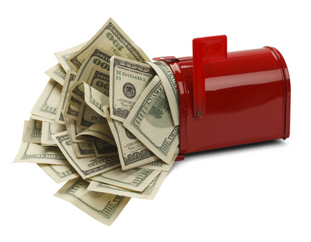 Red Mail Box with Money Pouring Out Isolated on White Background. Stock Photo