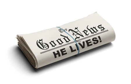 he: Newspaper With The Good News and the Headline He Lives printed on it Isolated On White Background. Stock Photo