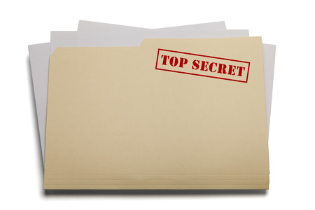 top secret: Folder and papers with the words Top Secret stamped on it, Isolated on a white background.