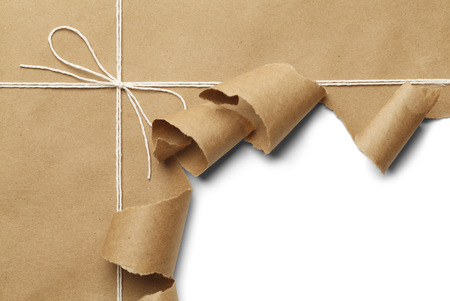 Brown Paper Parcel with Rope Torn Open on White Background.