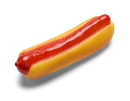 perro caliente: Squeaky pl�stico Hot Dog mascotas de juguete aisladas sobre fondo blanco.