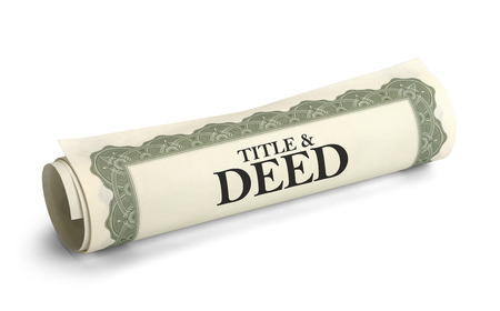 deed: Title and Deed Paper Document Rolled and Isolated on a White Background.