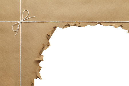 cut paper: Brown Paper Package with Rope Torn Open on White Background.