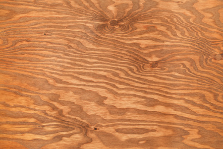 ply: Brown Stained Pine Ply Wood Textured Background.