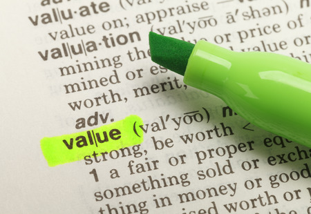 The Word Value Highlighted in Dictionary with Green Marker Highlighter Pen.