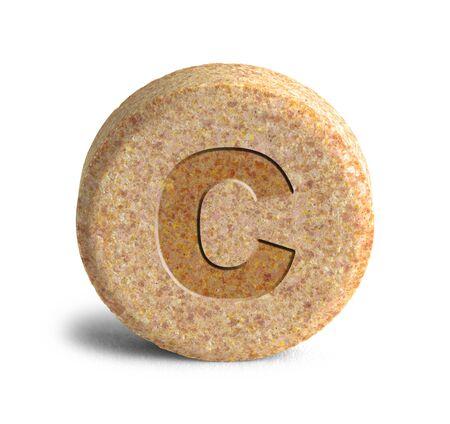 Large Orange Vitimin C Pill Isolated on White Background.