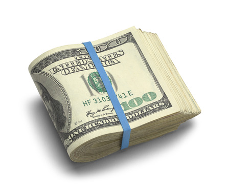 cash money: Gran Pila de Doblado cien dólares aislados en el fondo blanco. Foto de archivo