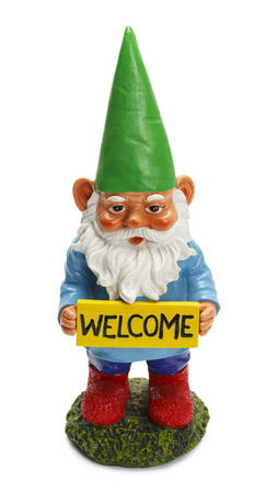 garden gnome: Garden Gnome Holding Welcome Sign Isolated on White Background. Stock Photo