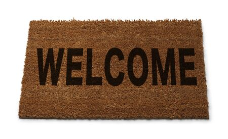 Natural Brown Door Mat with Welcome on it Isolated on White Background.