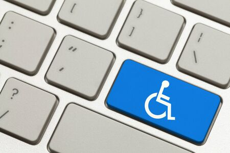 disabled parking sign: Close Up of Blue Handicap Key Button on a Keyboard. Stock Photo