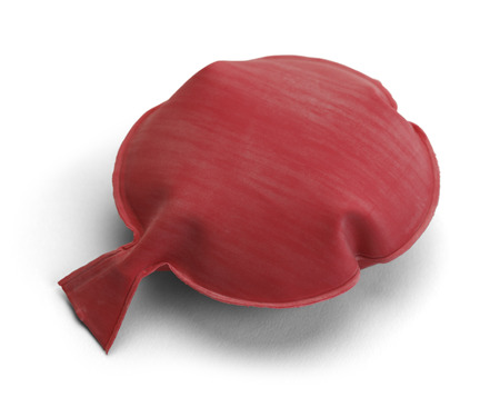 Red Rubber Noise Maker Isolated on a White Background. Banque d'images