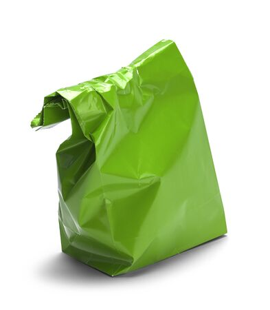 Wrinkled Green Paper Bag Lunch with Copy Space Isolated on White Background.